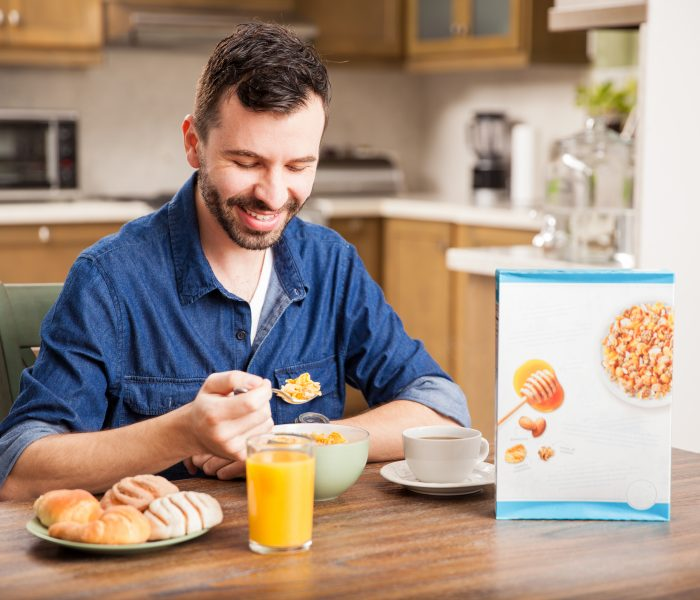 Guy eating cereal for breakfast