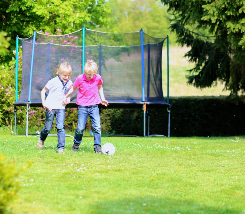 twins playing soccer